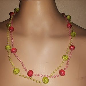 Two long neon pink and green necklaces